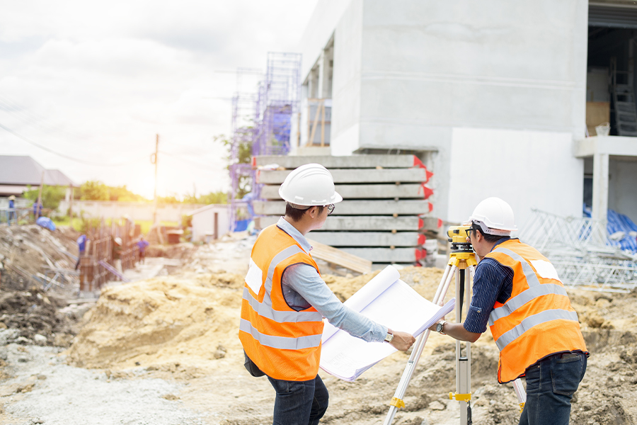 Specialized Business Insurance - Construction Engineer and Foreman Worker Checking a Construction Site Project